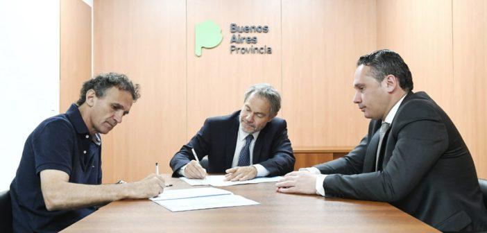 Katopodis y Ferrari, en la firma del convenio